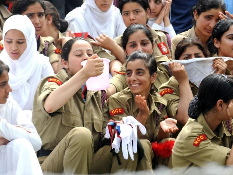 A National Cadet Corps youth drinks water from jug during a full dress rehearsal for India's Independence Day celebrations in Srinagar. AFP photo/Rouf Bhat