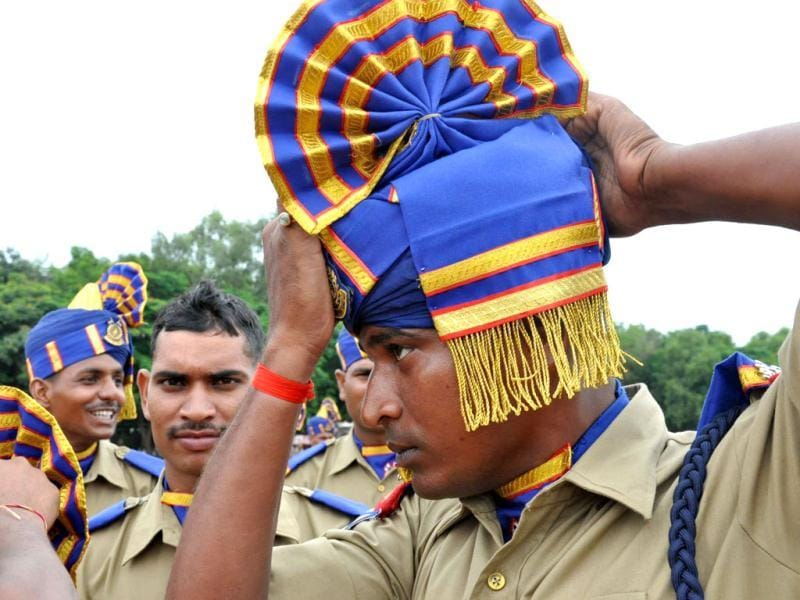 A CRPF jawan adjusting his haedgear during full dress rehearsal of the Independence Day Parade, at Morabadi Grounds in Ranchi. Agency