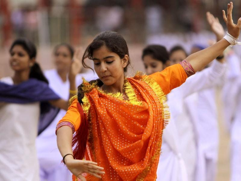 A young girl dances during the Independence Day celebration rehearsal in Jammu. AP photo/Channi Anand