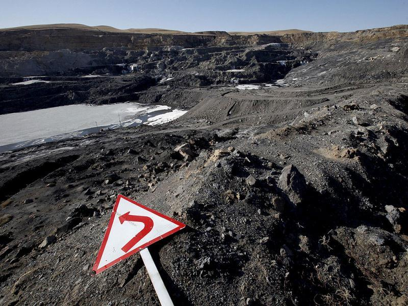 This handout picture shows a signpost on the ground at Yuejin open-cast coal mine in Xilin Gol, in China's Inner Mongolia. China is the world's biggest consumer of coal, relying on the fossil fuel for 70 percent of its growing energy needs. AFP PHOTO / GREENPEACE CHINA
