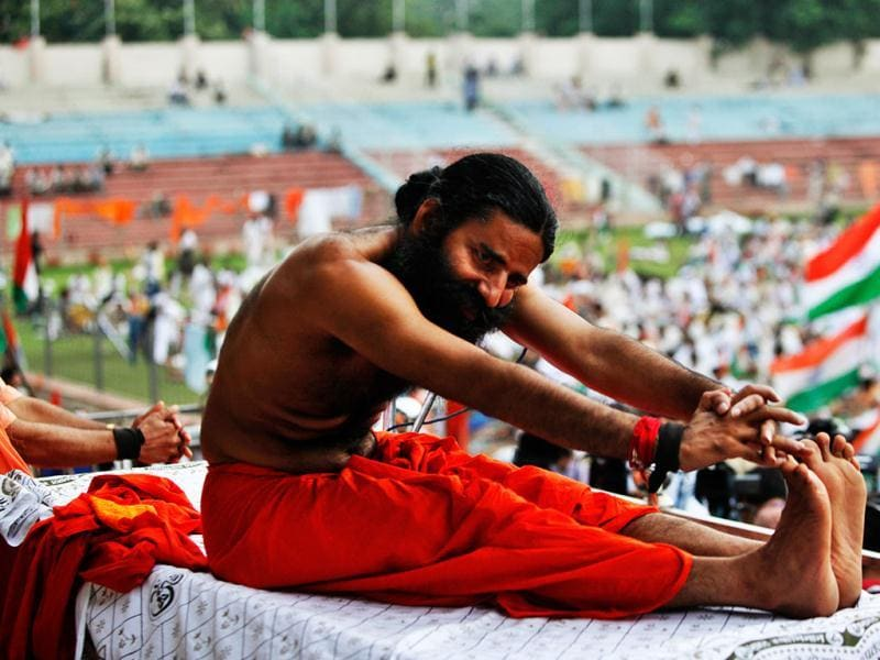 Yoga guru Baba Ramdev stretches during an anti-corruption protest in New Delhi. Ramdev sipped a glass of fruit juice offered by supporters ending his hunger strike but said his battle against endemic corruption in India will continue. (AP Photo/Rajesh Kumar Singh)