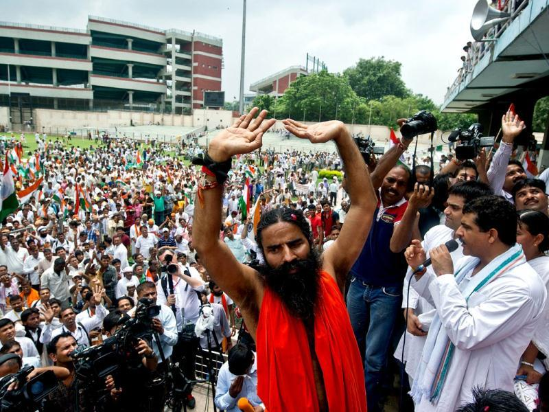 Yoga guru Baba Ramdev gestures after breaking his fast at Ambedkar stadium in New Delhi. AFP Photo/Prakash Singh