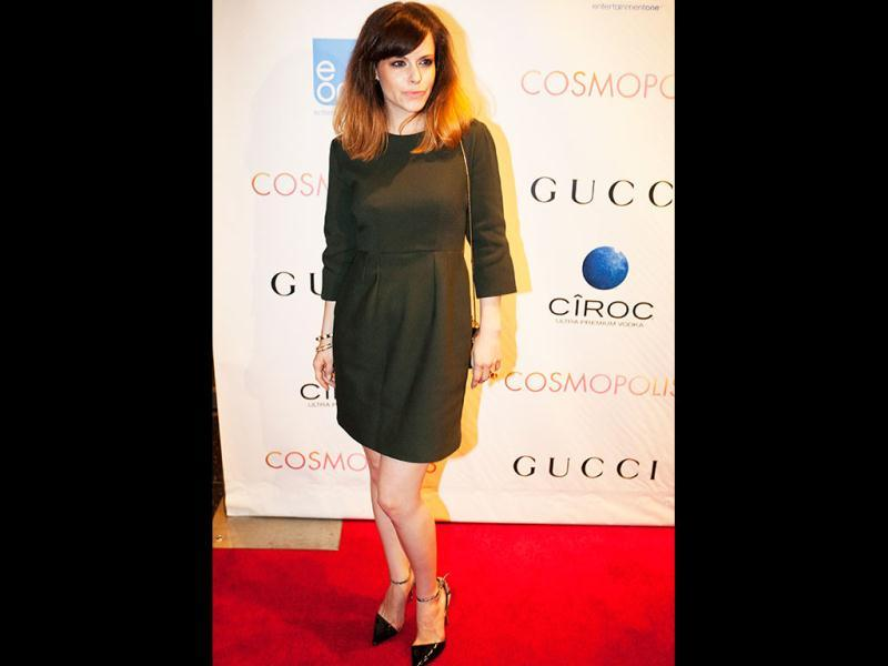Actress Emily Hampshire looks chic in a short dress during the event. (Reuters Photo)