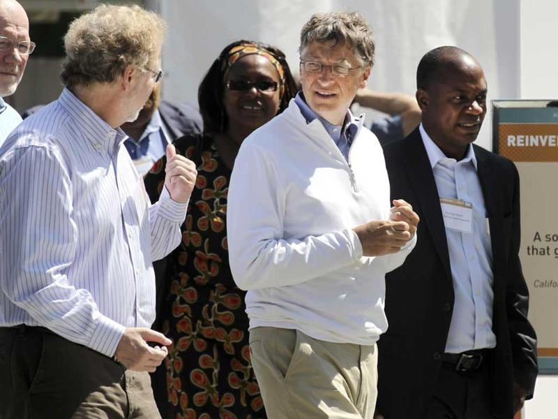 Bill Gates (R) and former Microsoft chief technology officer and co-founder of Intellectual Ventures Nathan Myhrvold speak while reviewing the displays at the 'Reinvent the Toilet Fair' competition at the Bill and Melinda Gates Foundation campus in Seattle, Washington. Reuters/Anthony Bolante
