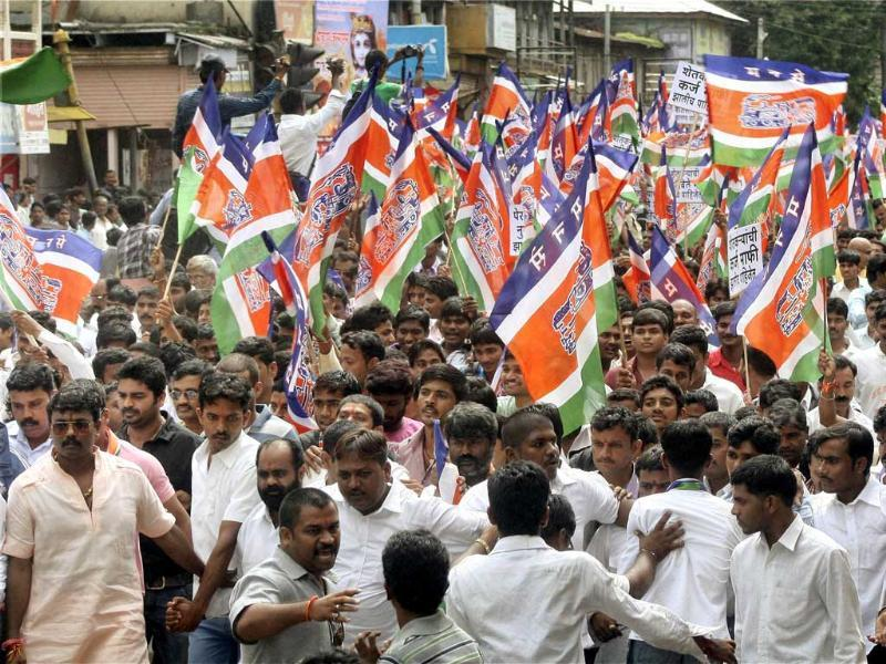 Thousands of MNS activists with farmers from drought-hit areas take part in the protest rally in Satara, Maharashtra. PTI photo