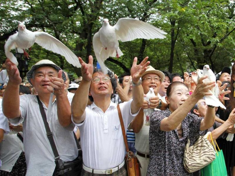 People release doves as a symbol of peace at the Yasukuni Shrine for the war dead in Tokyo, on the anniversary of Japan's surrender in World War II. Reuters/Issei Kato