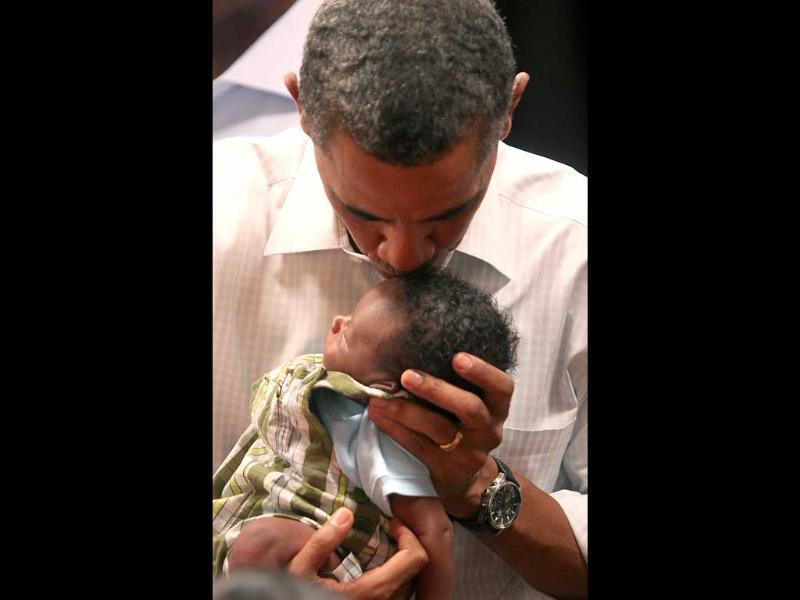President Barack Obama kisses the forehead of 3-week-old Ethan Muhire of Marshalltown, Iowa during a campaign stop in Marshalltown. AP/Bryon Houlgrave