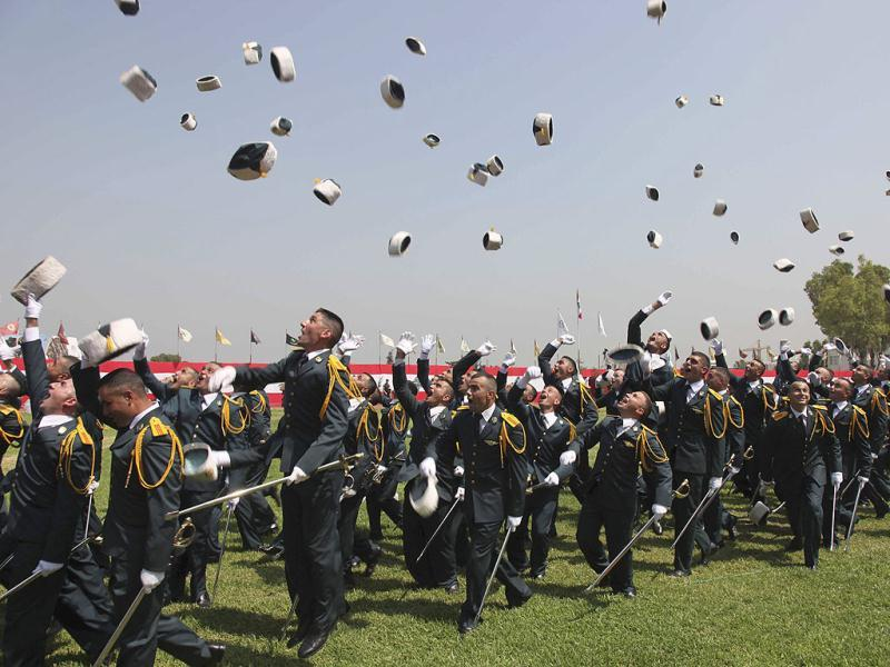 Lebanese officer cadets throw their hats in the air as they celebrate their graduation at a military academy in Fayadyeh, near Beirut. Reuters Photo