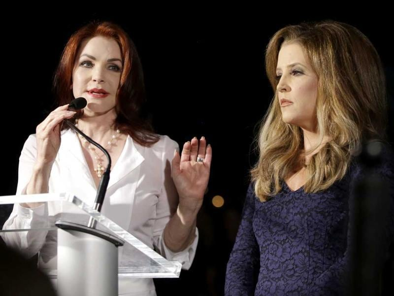 Priscilla Presley, left, and Lisa Marie Presley speak to fans gathered at a candlelight vigil at Graceland, Elvis Presley's Memphis home, to commemorate the 35th anniversary of Presley's death. AP/Mark Humphrey
