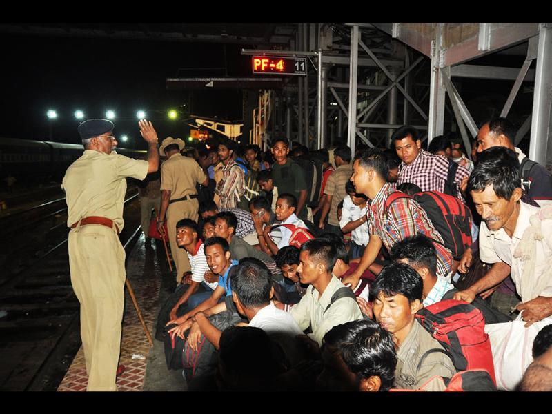 Northeast people being controlled by police at Bangalore city railway station. Photo by special arrangement