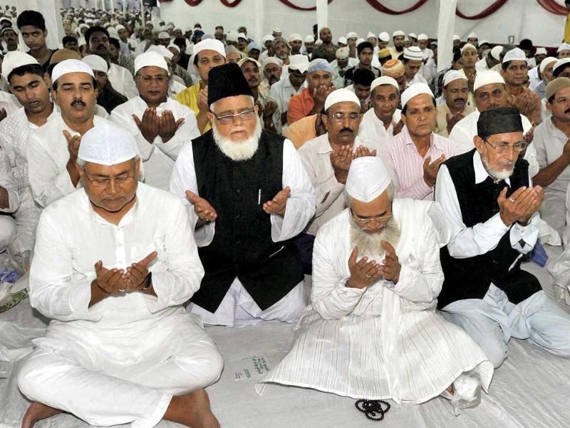 Bihar chief minister Nitish Kumar (L) offers Namaz of holy Ramzan before an Iftar with Muslims at his official residence in Patna. PTI photo