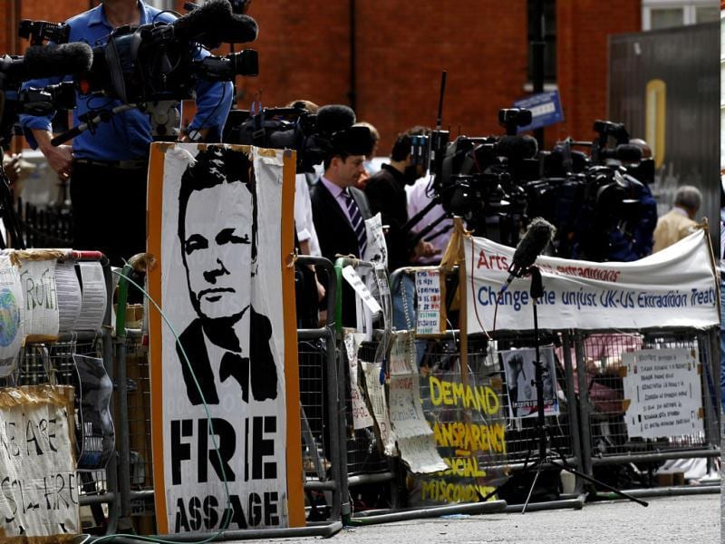 Media gather outside the Ecuadorian Embassy in central London, London. AP/Sang Tan