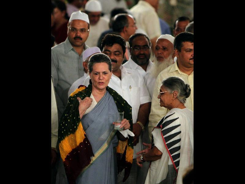 UPA chairperson Sonia Gandhi and Delhi cheif minister Sheila Dikshit at an Iftar Party hosted by Prime Minister Manmohan Singh at 7RCR in New Delhi. (PTI Photo/Vijay Verma)
