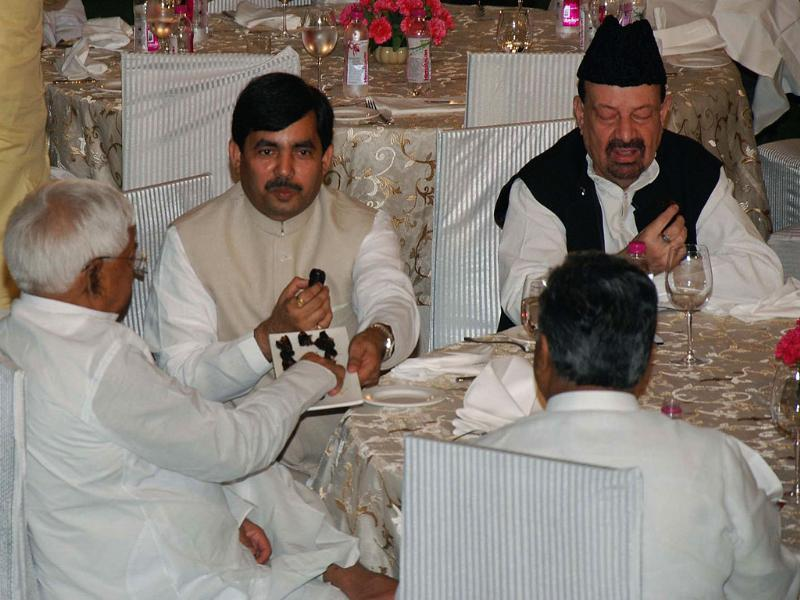 RJD president Laloo Prasad Yadav and senior BJP leader Syed Shahnawaz Hussain at an Iftar Party at an Iftar Party at Prime Minister's residence in New Delhi.