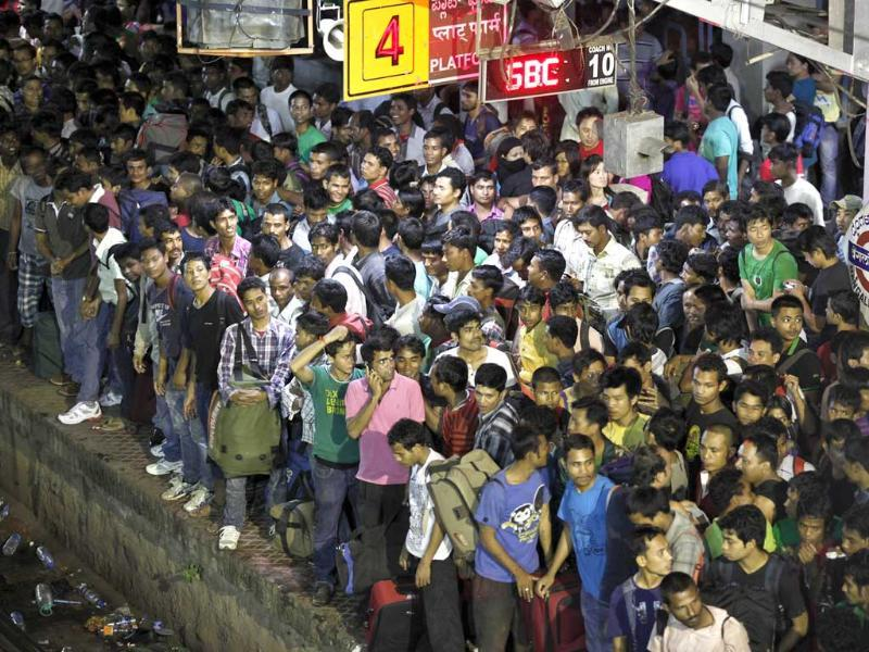 People from the northeast wait to board a special train to go back home, at a train station in Bangalore. AP/Aijaz Rahi
