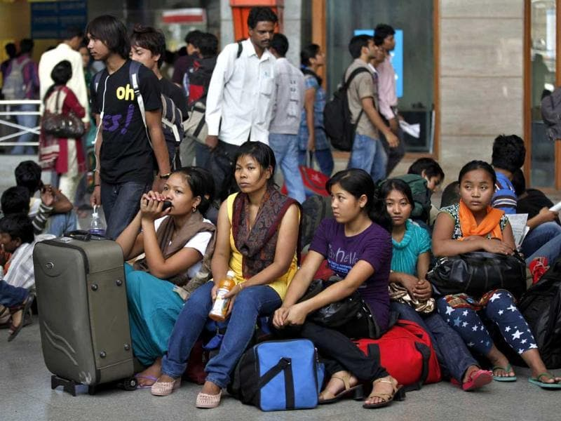 Northeastern women wait with their baggage to board trains home, at a railway station in Bangalore. Thousands of people from the northeast are fleeing the IT city, spurred by rumours they would be attacked in retaliation for communal violence in Assam. AP/Aijaz Rahi