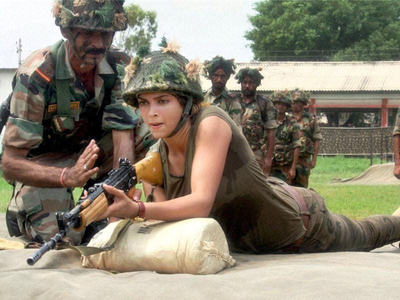My turn! An Army commando instructs Deepika Padukone as she tries her hand at the rifle during the shooting of NDTV India's Jai Jawan in Jammu.