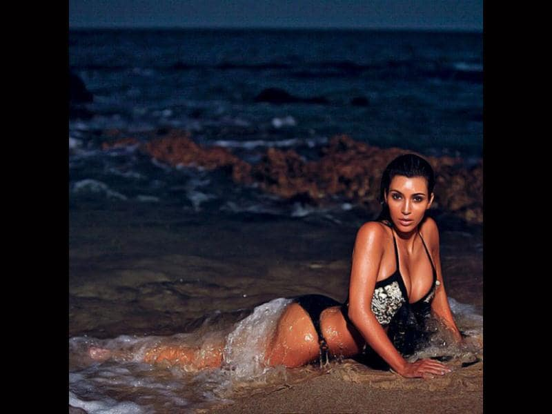 The sexy Kim Kardashian is seen here enjoying a late night swim in the sea for a photo-shoot. (Photo: Twitter)