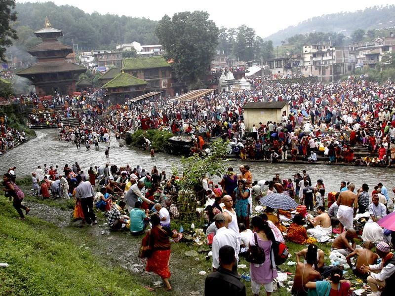Devotees gather at the Gokarneshwar temple to observe Kuse Aunsi at Gokarneshwar temple in Katmandu. AP Photo