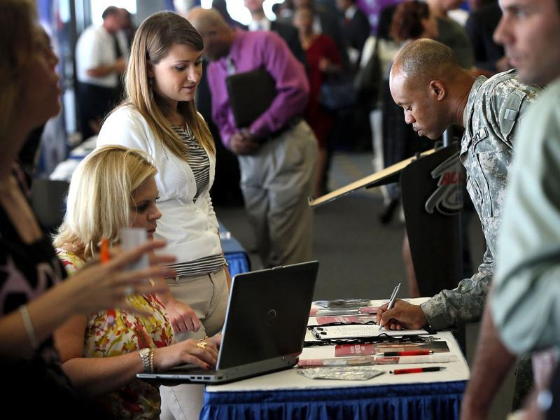 A job seeker puts down his information for recruiters during a Hiring Our Heroes job fair at Richmond International Raceway in Virginia. AFP/Alex Wong