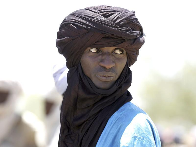 A Tuareg herdsman looks at livestock at the market in Bermo, Niger, 200 kms north of Maradi. AP/Jerome Delay