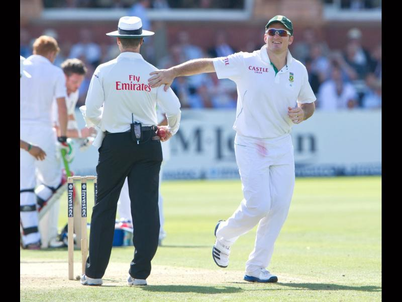 South Africa's Graeme Smith, right, pats umpire Simon Taufel on the back during the 2nd day of the third Test match against England at Lord's cricket ground, London. AP/Tom Hevezi