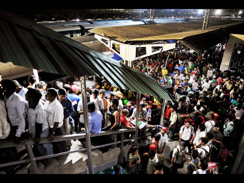 People from northeast wait to board a train at Bengaluru railway station to return to their homes after rumours of attacks. PTI Photo/Shailendra Bhojak