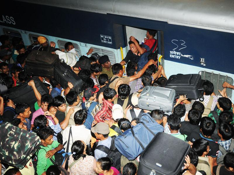 People from northeast board a special train at Bangalore city railway station. UNI Photo