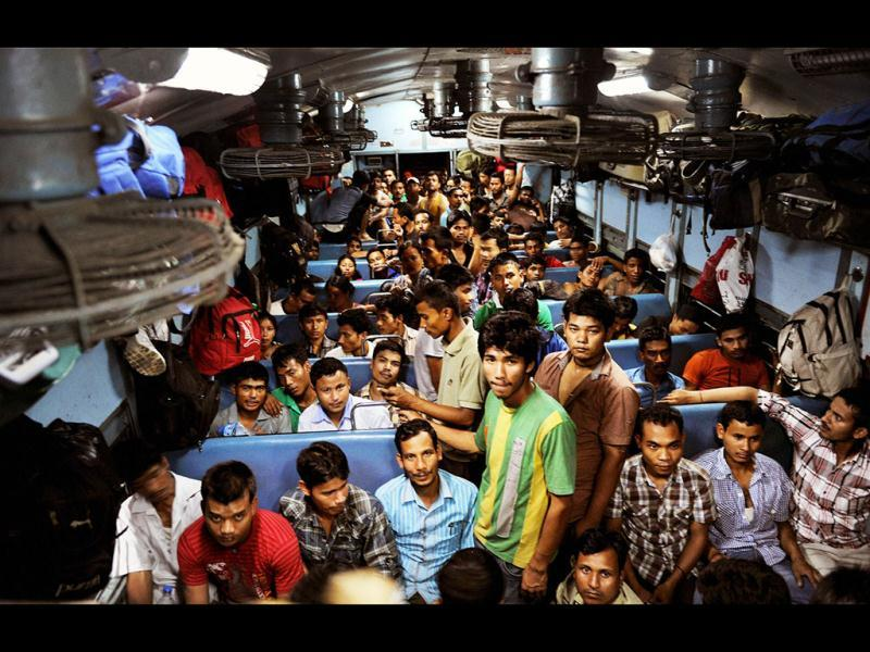 People from northeast sitting inside a train at Bengaluru railway station to return to their homes after rumours of attacks. PTI Photo/Shailendra Bhojak