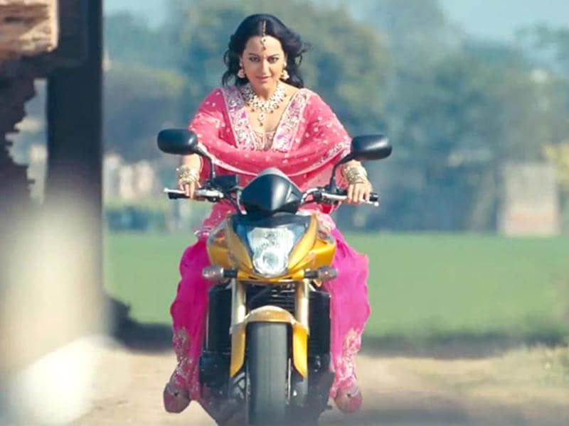 Actress Sonakshi Sinha rides a bike in one of the scenes from Son of Sardaar