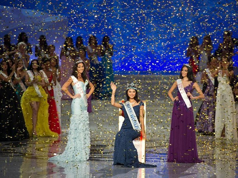 Yu Wenxia of China waves to the audience after being crowned the winner of Miss World 2012 during the pageant's final ceremony at the Ordos Stadium Arena in the inner Mongolian city of Ordos. AFP Photo