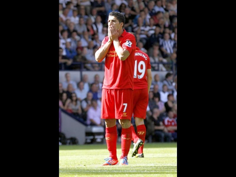 Liverpool's Luis Suarez reacts to his missed chance to score against West Bromwich Albion during their English Premier League soccer match at the Hawthorns, West Bromwich, England. (AP Photo)