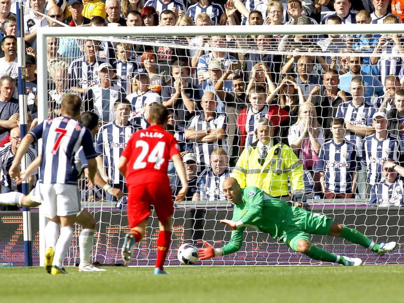 Liverpool's goalkeeper Pepe Reina, right, saves a penalty from West Bromwich Albion's Shane Long, hidden left, during their English Premier League soccer match at the Hawthorns, West Bromwich, England. (AP Photo)