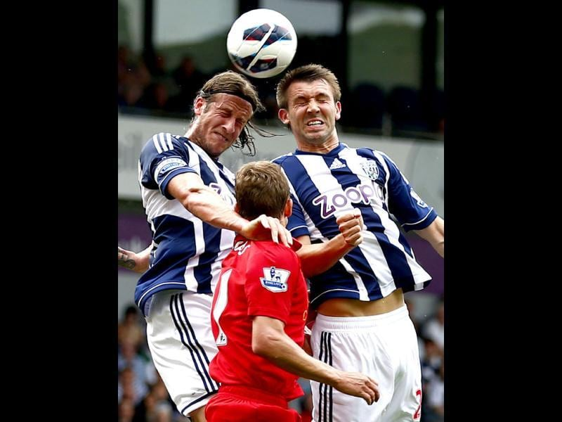Liverpool's Lucas Leiva (C) challenges West Bromwich Albion's Jonas Olsson (L) and Steven Reid during their English Premier League soccer match at The Hawthorns in West Bromwich, central England. (Reuters)
