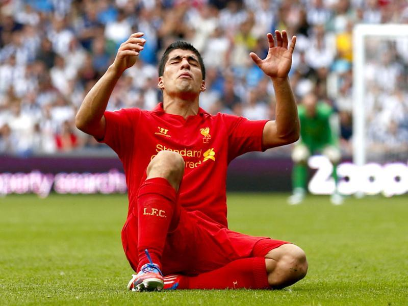 Liverpool's Luis Suarez reacts during their English Premier League soccer match against West Bromwich Albion at The Hawthorns in West Bromwich, central England. (Reuters)
