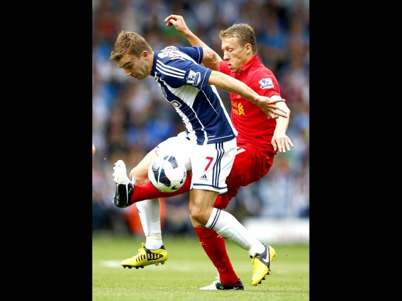 Liverpool's Lucas Leiva (R) challenges West Bromwich Albion's James Morrison during their English Premier League soccer match at The Hawthorns in West Bromwich, central England. (Reuters)