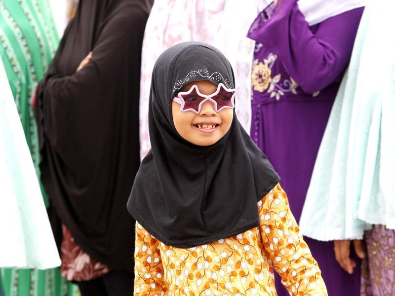 A girl smiles after a prayer session to celebrate Eid al-Fitr at Manila's Luneta Park. Reuters/Cheryl Ravelo