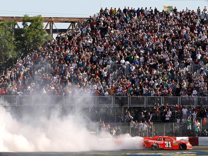 Justin Allgaier, driver of the Brandt Chevrolet, takes the checkered flag after winning the NASCAR Nationwide Series sixth annual Napa Auto Parts 200 presented by Dodge at Circuit Gilles Villeneuve in Montreal, Quebec, Canada. Tom Pennington/Getty Images for NASCAR/AFP