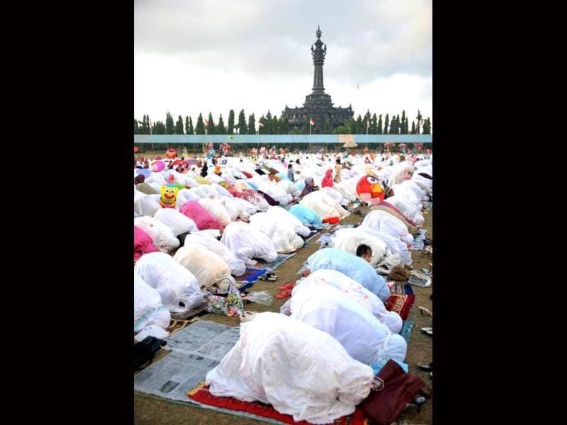 Indonesian Muslims attend prayer during Eid ul-Fitr at Bajra Sandhi monument and park in Denpasar on Indonesia's resort island of Bali. Muslims around the world celebrate Eid al-Fitr, marking the end of Ramadan, the Muslim calendar's ninth and holiest month during which followers are required to abstain from food, drink and sex from dawn to dusk. (AFP/Sonny Tumbelaka)