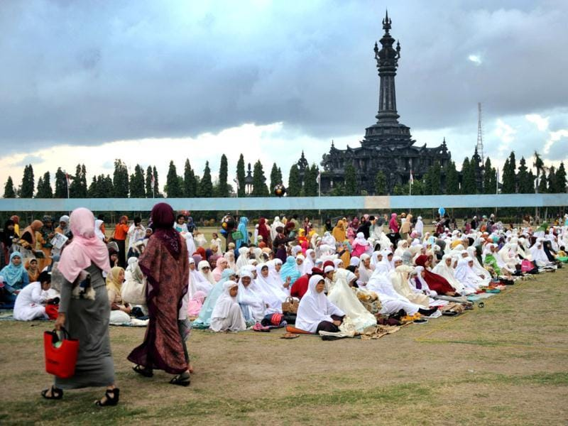 Indonesian Muslims attend prayer during Eid ul-Fitr at Bajra Sandhi monument and park in Denpasar on Indonesia's resort island of Bali. (AFP/Sonny Tumbelaka)