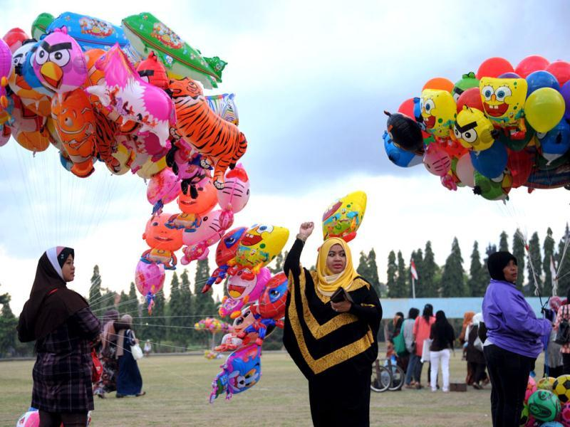 An Indonesian Muslim woman holds a balloon during Eid ul-Fitr at Bajra Sandhi monument and park in Denpasar on Indonesia's resort island of Bali. (AFP/Sonny Tumbelaka)