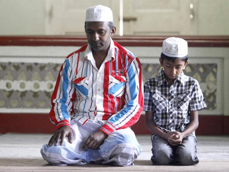 A man and a child pray at a mosque during a special prayer to celebrate Eid ul-Fitr in Kandy, Sri Lanka. (Reuters/Dinuka Liyanawatte)