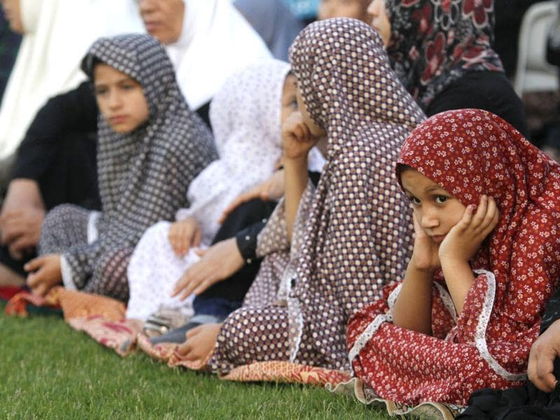 Palestinian girls attend the Eid ul-Fitr prayers in Palestine Stadium in Gaza City. (AP/Hatem Moussa)