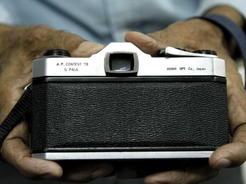 Photographer S Paul shows the Pentax camera in which his name was engraved as he was winner of the AP international contest in 1970. (Jasjeet Plaha/HT photos)