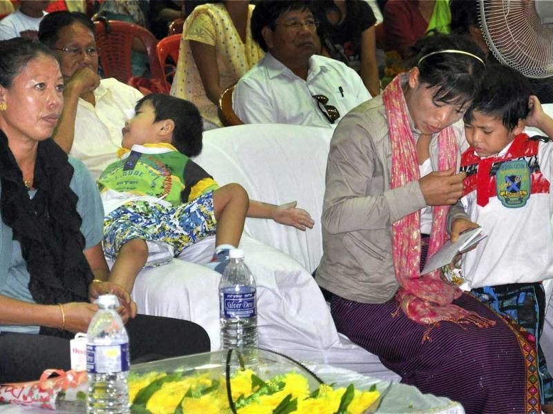 Olympics bronze medal winner boxer MC Mary Kom with her twin sons and mother during her welcome reception in Imphal. PTI Photo