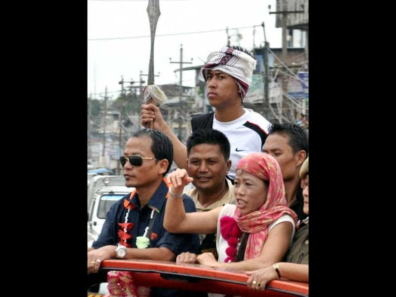 Olympics bronze medal winner MC Mary Kom waves to the crowd during her welcome reception in Imphal. PTI Photo
