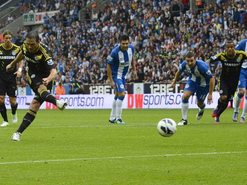 Chelsea's Frank Lampard (2nd L) shoots to score against Wigan Athletic during their English Premier League soccer match at the DW Stadium in Wigan, northern England. (Reuters)