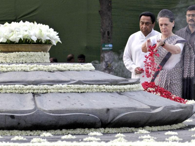 Congress chief Sonia Gandhi scatters rose petals at Rajiv Gandhi's memorial on the 68th birth anniversary of the former Prime Minister, as the urban development minister Kamal Nath (3rd R) watches in New Delhi. Reuters/B Mathur