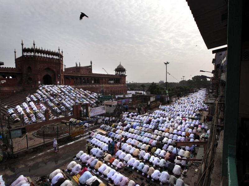 People offer Eid al-Ftr prayer at the Jama Masjid, in New Delhi. Muslims around the world celebrate Eid al-Fitr, marking the end of the holy month of Ramadan. AP Photo/ Manish Swarup