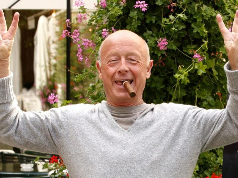 Director Tony Scott poses during a photocall in Paris. Hollywood filmmaker Scott, director of such big-screen action hits as